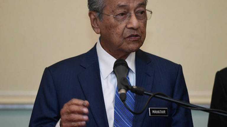 Tun M worried about job losses from planned Telenor, Axiata merger
