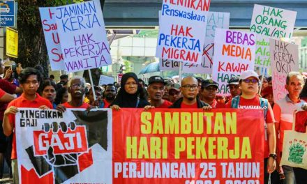 At May Day gathering, workers demand better pay and fairer treatment